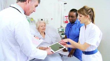 Doctor Nurses Bedside Mature Female Patient Wireless Tablet — Stock Video