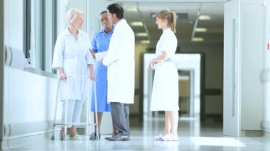 Elderly Patient Medical Staff Working Busy Hospital Facility — Stock Video