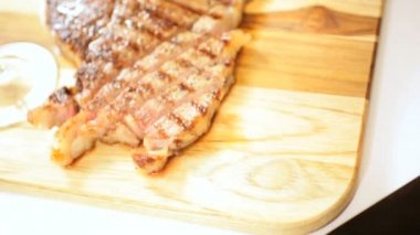 Cooked Healthy Lean T-Bone Steak Glass Red Wine — Stock Video