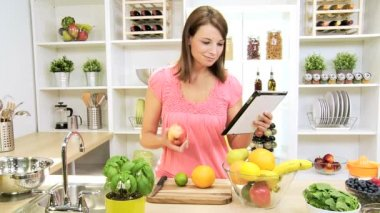 Caucasian Female Using Wireless Tablet Home Kitchen — Stock Video