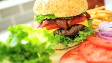 Burger Bun Filled Minced Beef Fresh Salad Vegetables Close Up — Stock Video