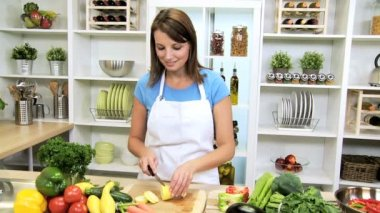 Healthy Caucasian Girl Slicing Fresh Vegetables — Stock Video