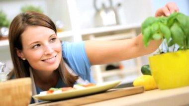 Girl adding basil to buffalo mozzarella — Stock Video