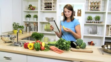 Caucasian Girl Using Recipe Wireless Tablet Healthy Living — Vídeo Stock