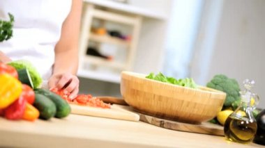 Girl at kitchen preparing tomatoes — Stock Video