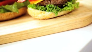 Bread Bun Filled Beef burger Topped Fresh Bacon Cheese — Stock Video