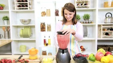 Young Female Using Blender Organic Fruit Drink — Stock Video