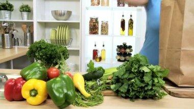 Caucasian Female Unpacking Shopping Bag Vegetables — Stock Video
