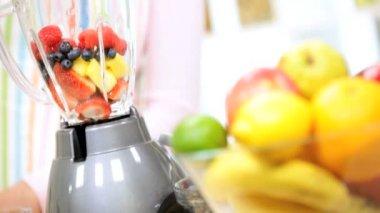 Female using freshly orange juice — Stock Video