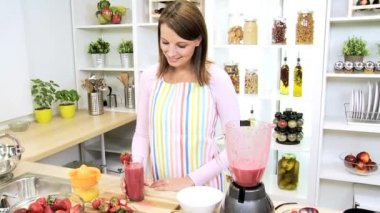 Caucasian Girl Displaying Glass Homemade Fruit Smoothie — Vídeo Stock