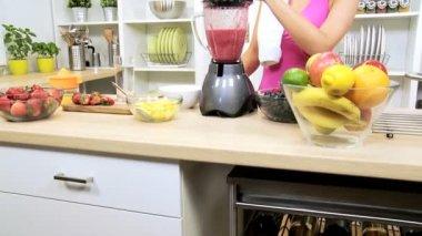 Brunette Girl Using Blender Fresh Fruit Juice After Workout — Stock Video