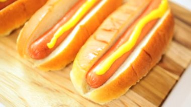 Close Up Hot Dogs Dressed Mild Yellow Mustard — Stock Video