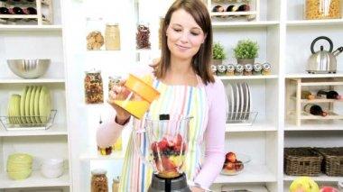 Brunette Girl Using Blender Fresh Fruit Juice — Stock Video
