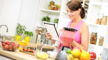 Girl using wireless tablet prepare fruit smoothie — Stock Video