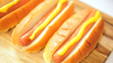 Hot dogs with mustard topping — Vídeo de Stock