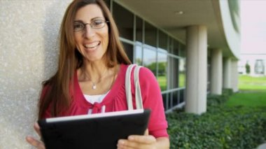 Female college tutor using tablet — Stock Video