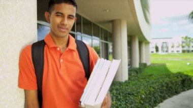 Male student carrying library books — Stock Video