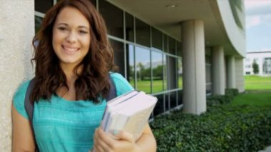 Female student carrying library books — Stock Video