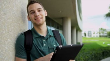 Male student with wireless tablet — Stock Video