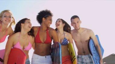 Teenagers having fun on beach — Stock Video