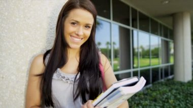 Female student holding library books — Stock Video