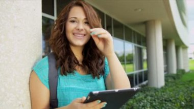 Female student with wireless tablet — Stock Video