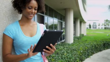 Female student holding wireless tablet — Stock Video