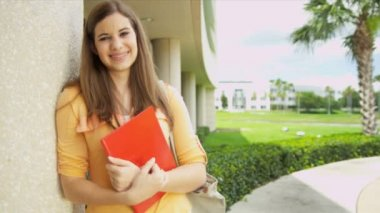 Female student holding workbook — Stock Video