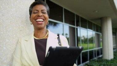 Female college president using tablet — Stock Video
