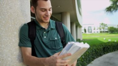 Male student holding library books — Stock Video