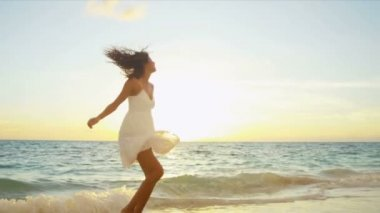 Carefree girl enjoying at beach by the  ocean — Stock Video