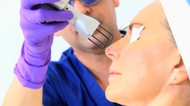 Cosmetic surgeon performing facial treatment — Stock Video