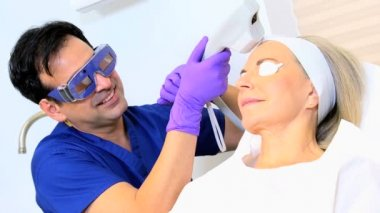 Female patient receiving cosmetic laser treatment — Stock Video