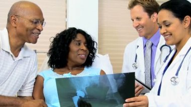 Radiology staff discussing x-ray result with patient — Stock Video