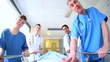 Nursing staff escorting patient in bed — Stock Video