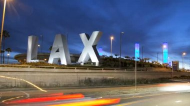 LAX sign zoom dusk traffic International Airport Los Angeles USA — Stock Video