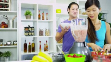 Healthy Ethnic Couple making Homemade Smoothie Together — Stock Video
