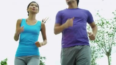 Couple in sportswear jogging out — Stock Video