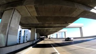 Driving vehicle below elevated Highway — Stock Video