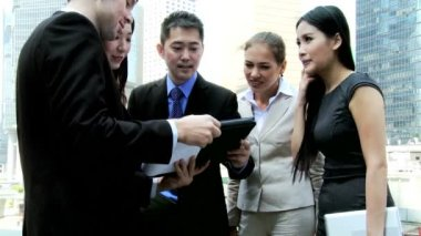 Business colleagues using wireless technology outdoors — Stock Video