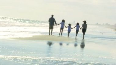 Parents and daughters on beach — Stock Video
