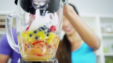 Health Conscious Asian Chinese Couple Making Organic Fruit Drink — Stock Video
