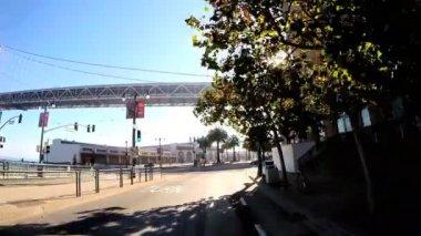 Vehicle driving coastal bay road — Stock Video