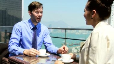 Business associates in rooftop restaurant — Stock Video