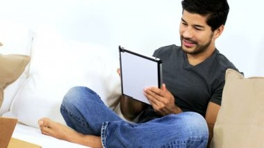 Man on couch using tablet — Stock video