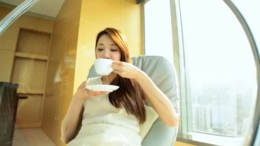 Woman drinks coffee in hotel — ストックビデオ