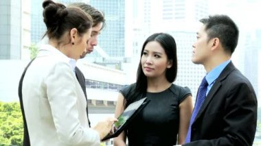 Business team discussing outside office — Vídeo stock