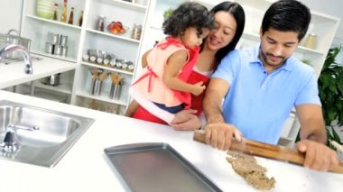 Girl with parents making cookie — Vídeo stock