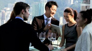 Financial brokers in rooftop restaurant — Stock Video