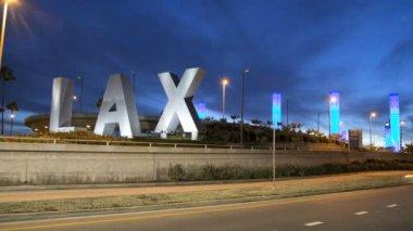 LAX sign night traffic International Airport Los Angeles — Stock Video